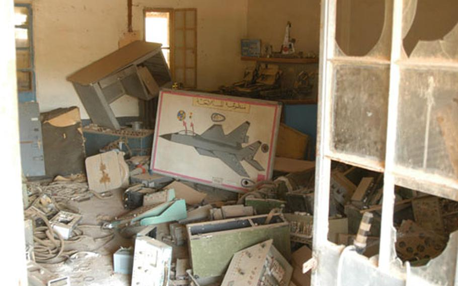The houses and barracks close to the airstrip at Camp Habbaniyah, Iraq, are full of aircraft parts that Iraqis tried to hide from Coalition bombers last year.