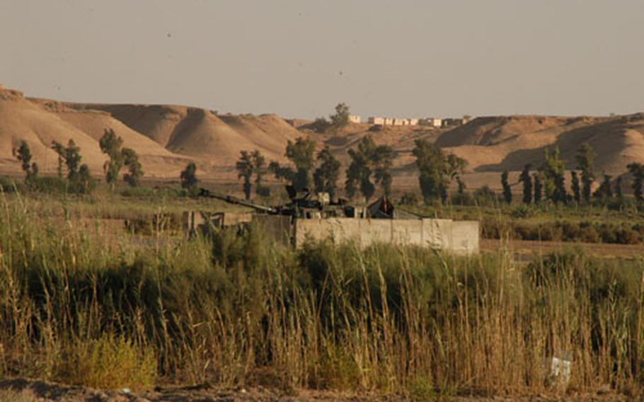 Camp Habbaniyah, Iraq, is an oasis of green surrounded by a desert.