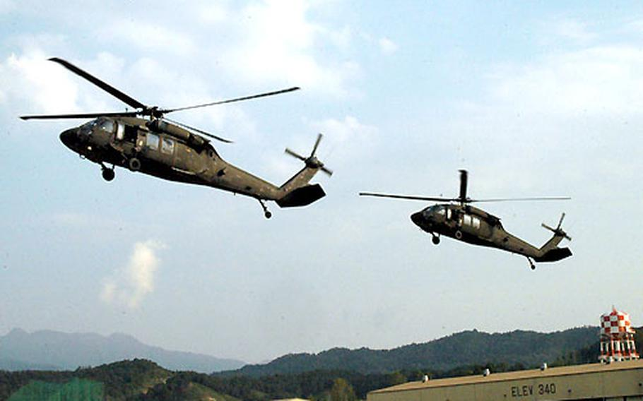 Helicopters from 2nd Battalion, 2nd Aviation Regiment, arrive at Camp Eagle, South Korea as part of a simulated air assault mission.