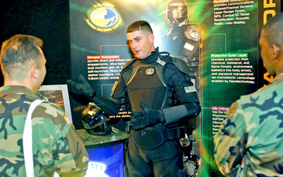 Staff Sgt. Raul Lopez, center, models a concept uniform being developed for soldiers of the future by the U.S. Army Natick Soldier System Center of Natick, Mass.