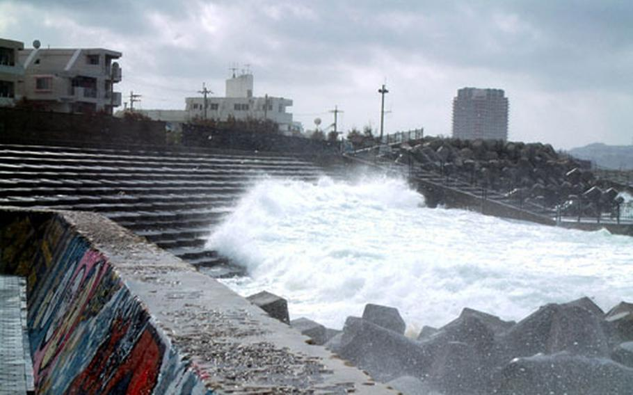 Seas stirred up by Typhoon Meari rush up the steps of the Sunabe Seawall on Okinawa Tuesday morning.