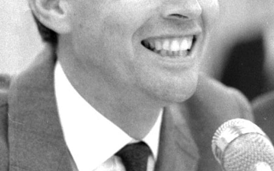 Dr. Christiaan Barnard talks to the press at Frankfurt, Germany, in March, 1968.