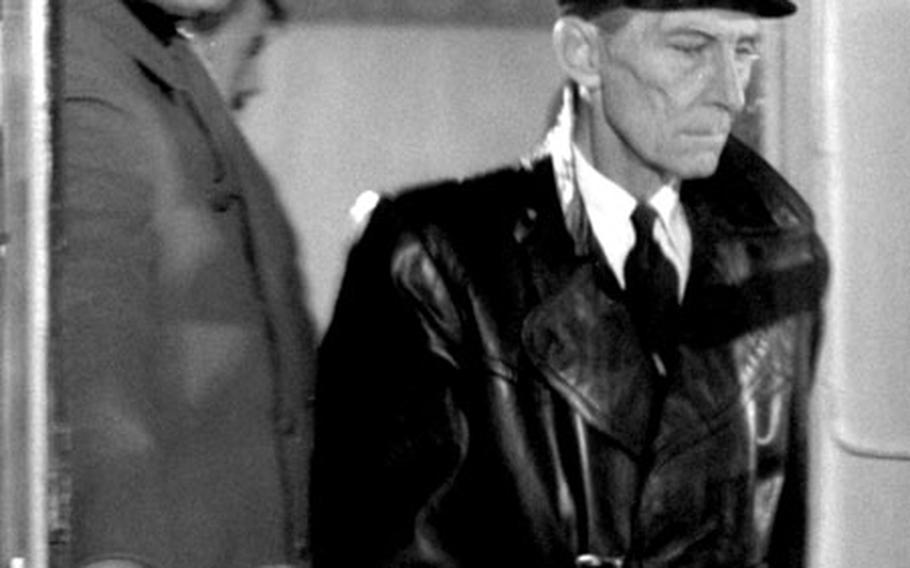 Leo Gordon and Peter Cushing film a scene.