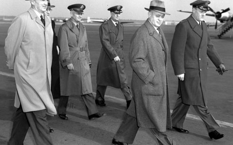U.S. Senators Stuart Symington (D-Mo.), left, and Styles Bridges (R-N.H.) walk with leaders of U.S. forces in Europe after arriving at Rhein-Main in February, 1954.