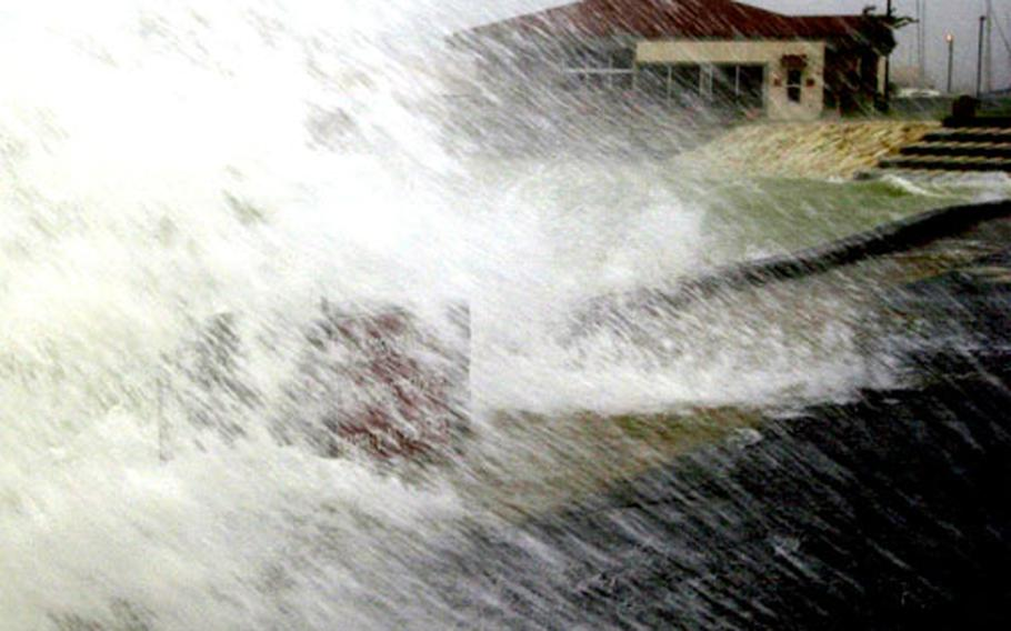 Ocean water crashes over the seawall at the Kadena Marina, as Typhoon Saomai stirs things up on Okinawa on Sept. 13, 2000.