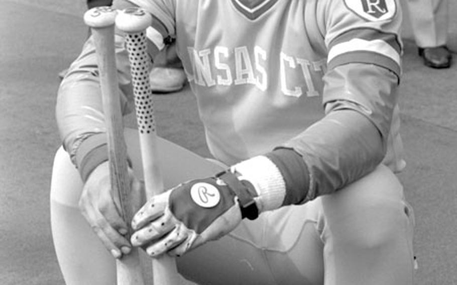 George Brett of the Kansas City Royals checks out some bats during a 1981 workout at Tokyo's Korakuen Stadium ...
