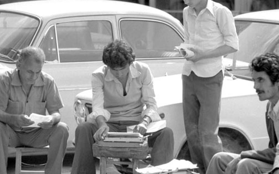 Typists set up shop outdoors in a square in Adana, Turkey, in May, 1979.