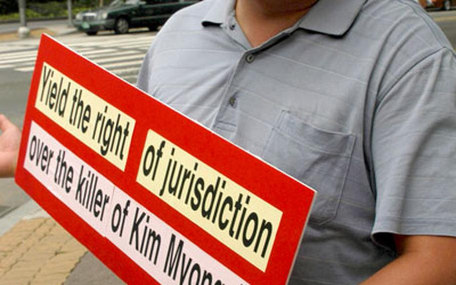 Kang Hong-gu, 39, a leader of a civic association in Dongducheon, talks Tuesday afternoon about why he believes South Korea should have criminal jurisdiction in an incident in which a South Korean woman was killed. Kim Myong-ja, 51, was killed June 10 when a U.S. military truck driven by a U.S. soldier struck and killed her.