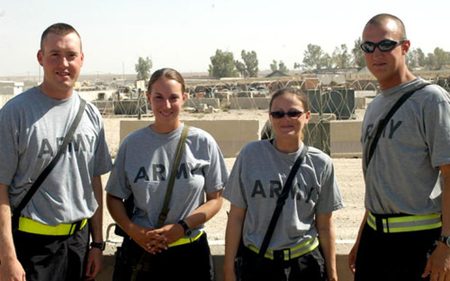 From left, 1st Lt. Joshua Sprowls, 1st Lt. Heather Sprowls, Spc. Dawn Andreli and Spc. Ivan Andreli make up two of the seven married couples serving with the 94th Engineer Combat Battalion (Heavy) and its attached unit, the 535th Engineer Company (Combat Support Equipment) in Mosul, Iraq.