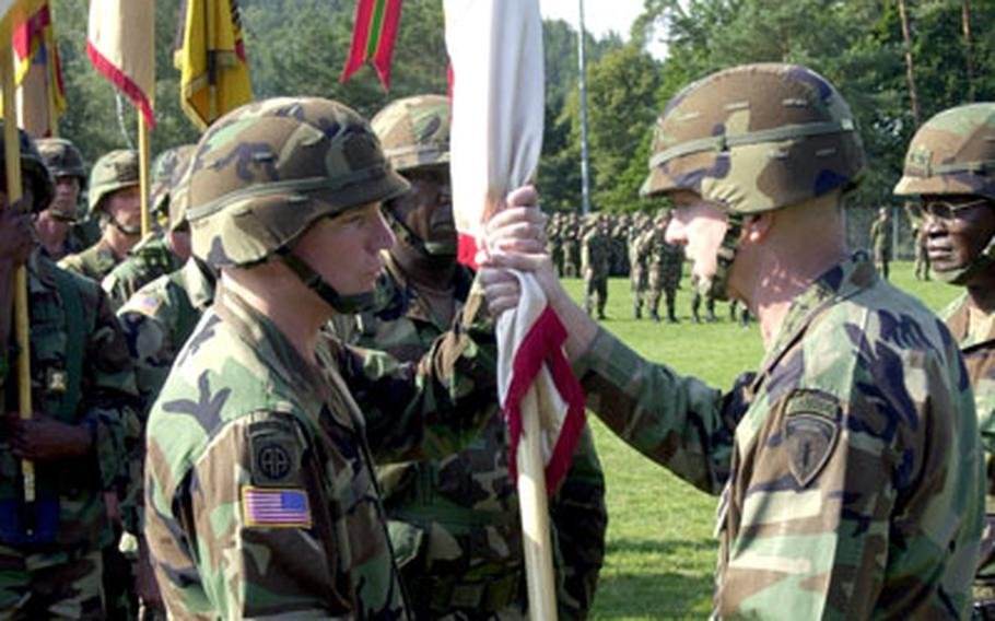 Gen. B.B. Bell, U.S. Army Europe commander, hands over command of the 21st Theater Support Command to Brig. Gen. Scott G. West, left., during a Thursday ceremony.