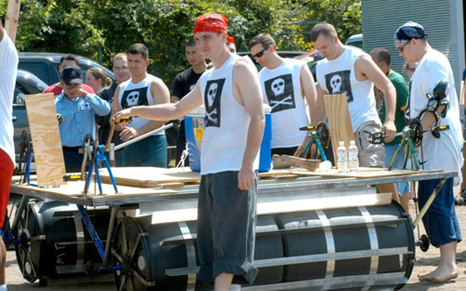 """The Aircraft Intermediate Maintenance Department (500 division) team's """"The Rum Runner"""" won most innovative boat for its use of bicycle pedals and other parts — but the metal-laden vessel sank Thursday."""