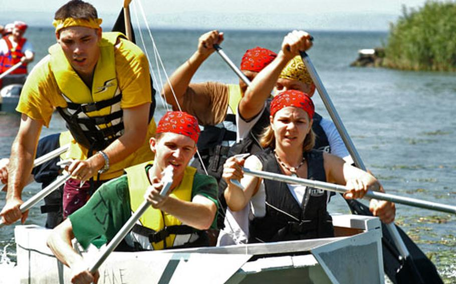 A team of sailors from Naval Air Facility Misawa's operations department paddles into shore and first place. The team, in its simplistic wooden, bath-tub shaped boat, took home top honors.