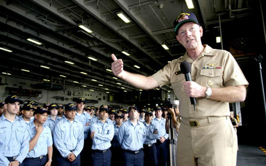 Vice Adm. Gerald Hoewing, chief of naval personnel, speaks with USS Kitty Hawk sailors about upcoming changes in the Navy. Hoewing also serves as deputy chief of naval operations for manpower.