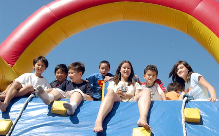 Children enjoy the bouncy castle at the Camp Red Cloud Labor Day block party.