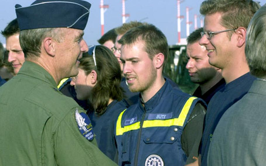 Maj. Gen. Bob Dulaney, left, director of Air and Space Operations for U.S. Air Forces in Europe headquarters, shakes hands with one of the 94 German volunteers going to New Orleans to help pump water out of the flooded city.
