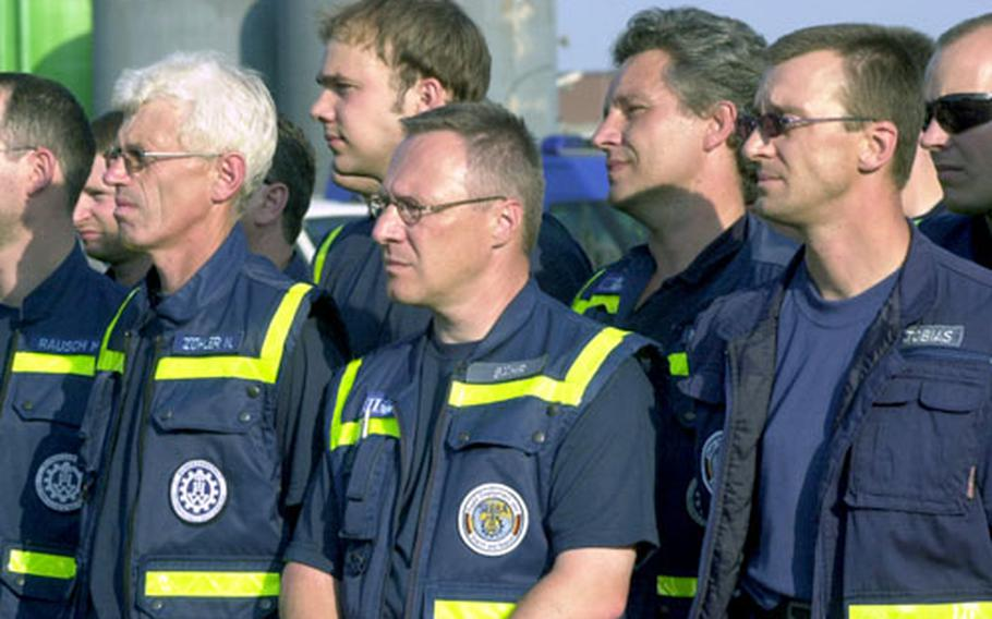 German volunteers from the humanitarian organization THW prepare to leave Ramstein Air Base for New Orleans.
