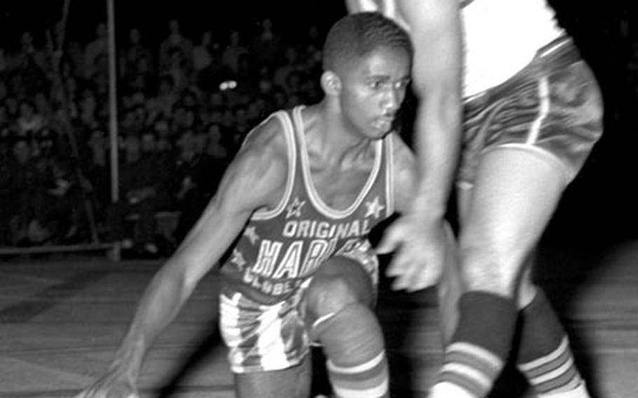 Marques Haynes shows off his legendary dribbling during the Harlem Globetrotters' game at Munich. Germany, in August, 1951.