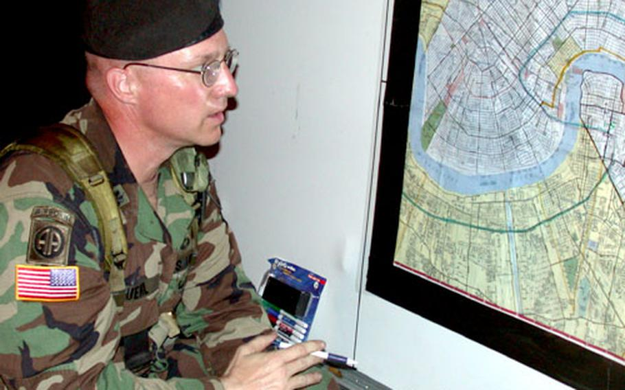 Lt. Col. Dale Kuehl, commander of the 1st Cavalry Division's 1-5 battalion, 2nd brigade, goes over his assigned sector before sending his soldiers on patrol Wednesday night in the Algiers section of New Orleans.