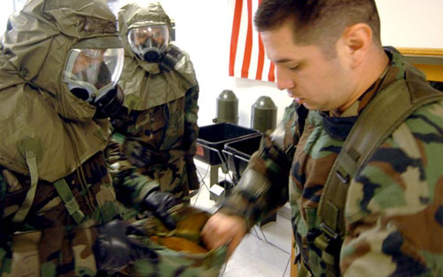 Staff Sgt. Gerald Benitez, right, instructs airmen on how to remove gear safely during the ORE on Saturday.