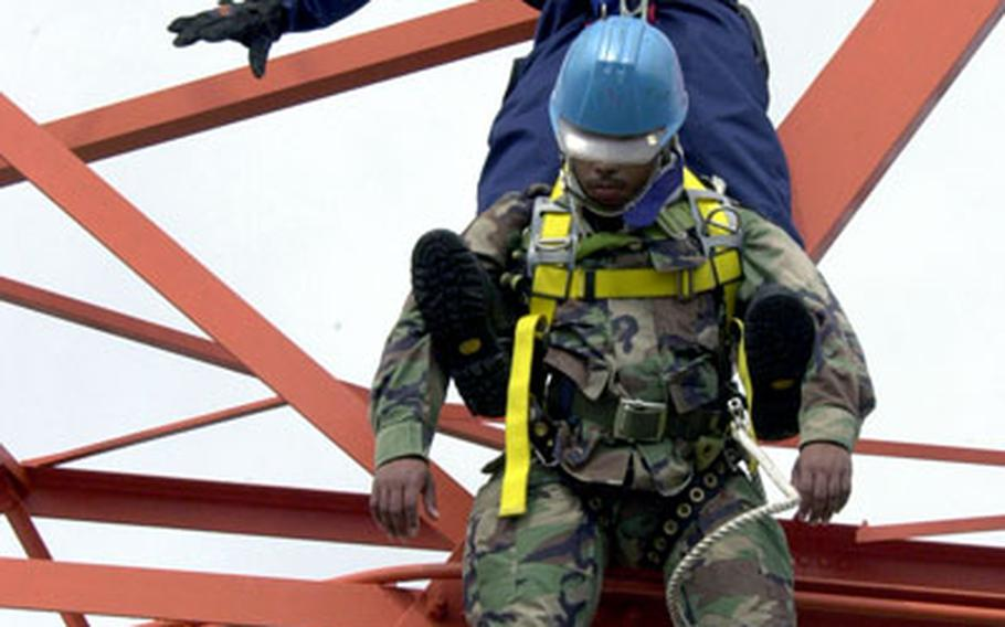 Yogi Manabu, top, guides Army Sgt. David Gonzalez to the ground during Friday's drill.