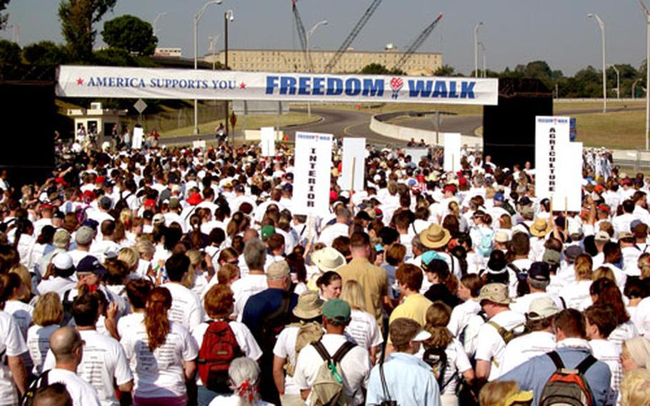 Participants in Sunday's Freedom Walk, designed to commemorate the Sept. 11 attacks and show support for overseas military, begin the two-mile march from the Pentagon to the National Mall. More than 13,000 people registered for the event, according to Pentagon officials.