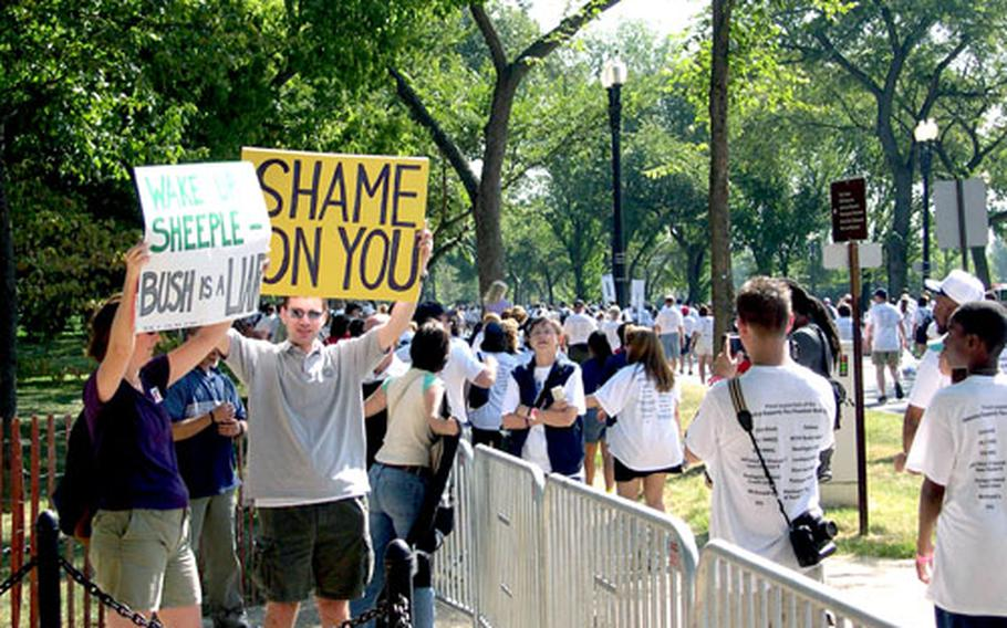 Protesters jeer marchers near the National Mall during Sunday's Freedom Walk in Washington, D.C.