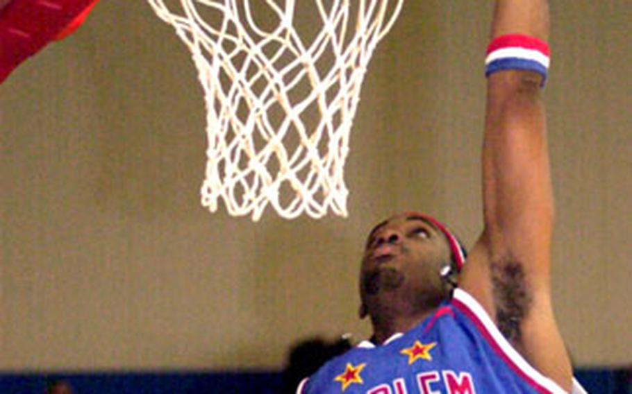 Donald Ray Cole goes up for a slam dunk.