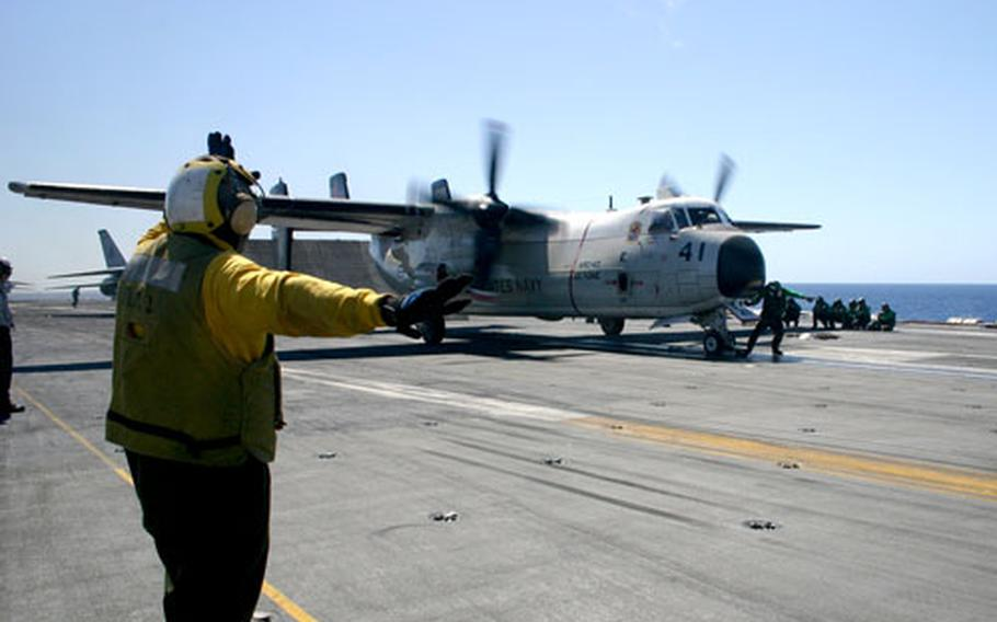 A U.S. Navy C-2 Greyhound prepares to launch from the aircraft carrier USS Theodore Roosevelt. The aircraft carrier's catapults will launch the aircraft from 0 mph to 130 mph within 2.5 seconds.