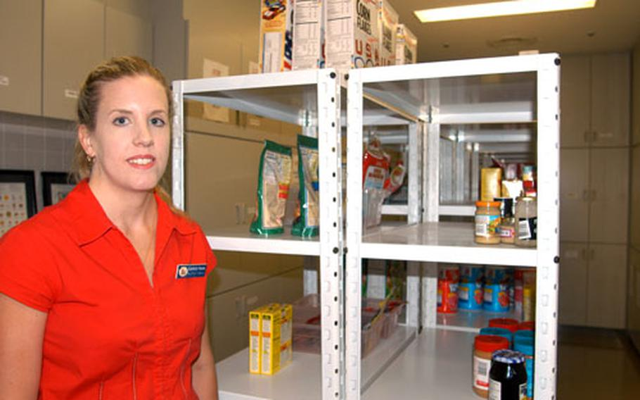 Kimberly Staton, Family Services coordinator, stands inside the food pantry at Misawa Air Base, Japan. The pantry is in need of canned, boxed and bagged goods donations.