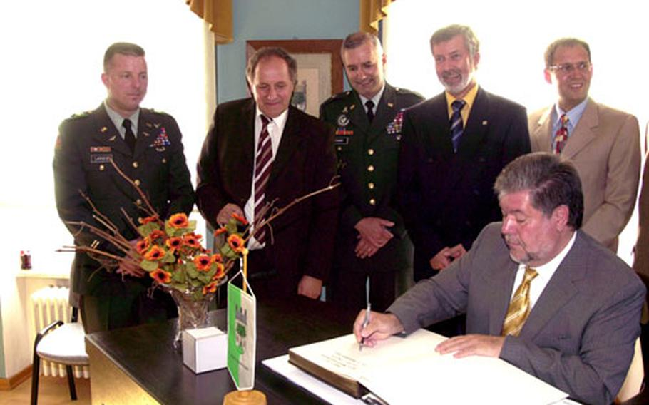 Lt. Col. James Larsen, far left, and Brig Gen. Michael Tucker, third from left, met with local leaders during a recent visit to Baumholder by Rheinland-Pfalz Pres. Kurt Beck, seated. Baumholder city officials and police want Army officials to help curb a recent rash of incidents involving soldiers.