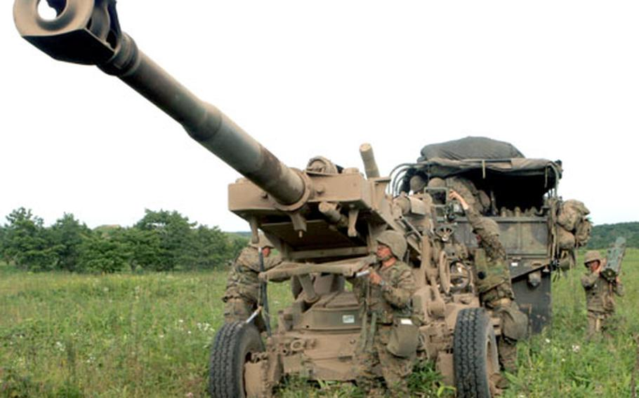 Marines with the 12th Marine Regiment from Camp Hansen, Okinawa, set up a 155 mm howitzer in preparation for live-fire training in Hokkaido.