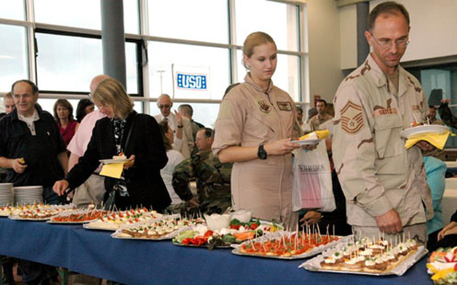 Transient troops, volunteers and visitors grab a bite to eat at the Rhein-Main USO's closing ceremony on Friday.