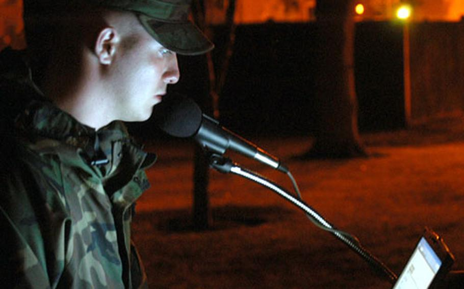 Taking a 15-minute turn in reading from the long list of American servicemembers who have been taken as prisoners of war or been listed as missing in action since the end of World War II, Airman 1st Class Jason Hitchcock from the 352nd Maintenance Squadron calls out names early Friday morning at RAF Mildenhall.