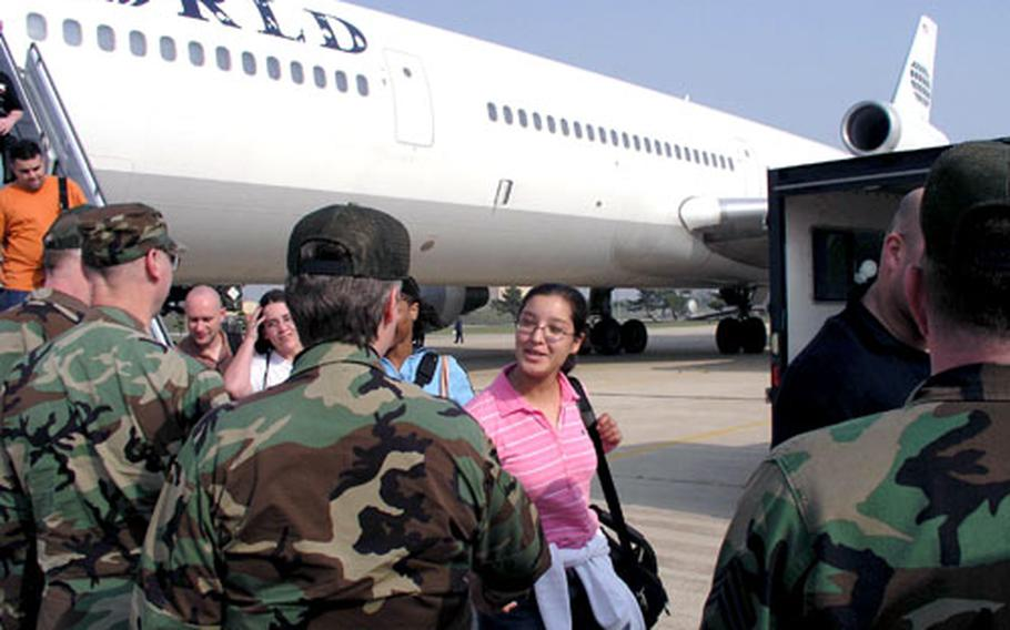 Airmen are greeted as they arrive at Kunsan Air Base in South Korea aboard a chartered Patriot Express flight.