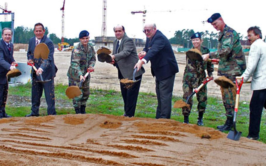 Officials at the Grafenwöhr, Germany, training area toss the first spadefuls of dirt at the construction site for the base's new shopping center, a greatly expanded mall that will include a post exchange, commissary, food court and various smaller shops.