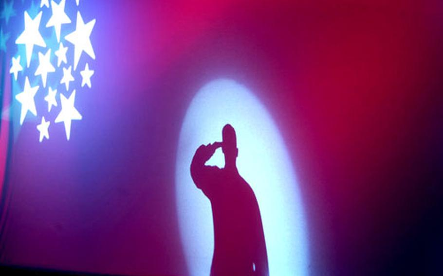 """The U.S. Army Soldier Show 2005 opened at Yongsan Garrison on Saturday with audience members singing the national anthem while a silhouette of a """"saluting soldier"""" was shown on a screen."""