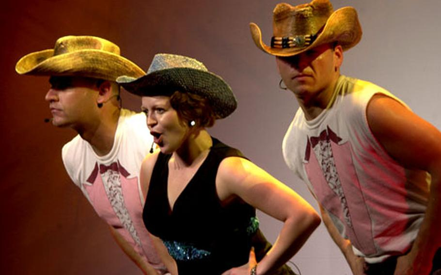 First Lt. Brandy Culp and two other soldiers perform a skit Saturday night during the U.S. Army Soldier Show.