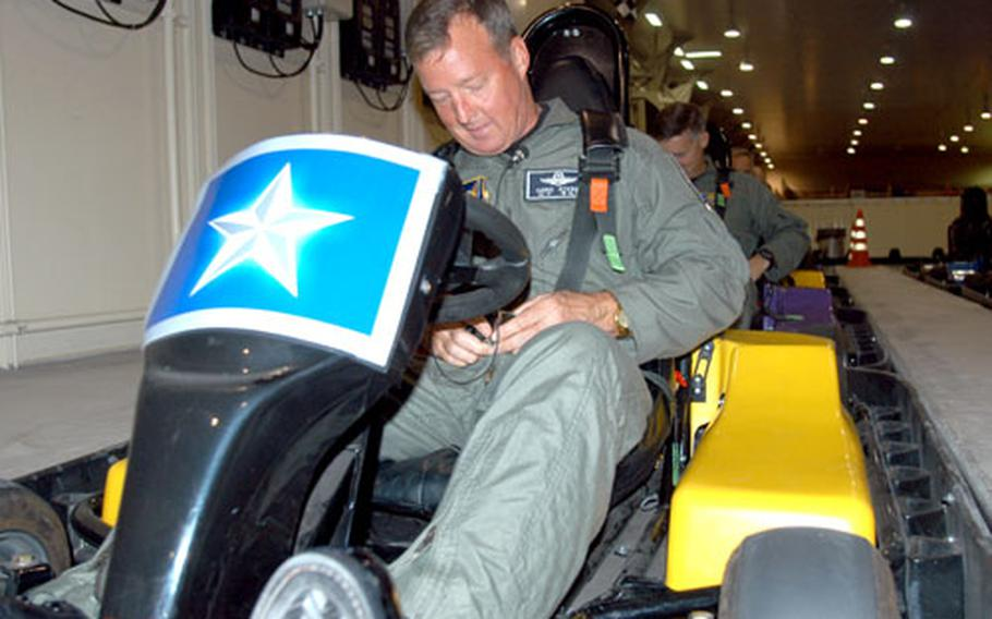 Brig. Gen. Dana T. Atkins takes a spin in the Weasel's Den's Go Karts on Friday.