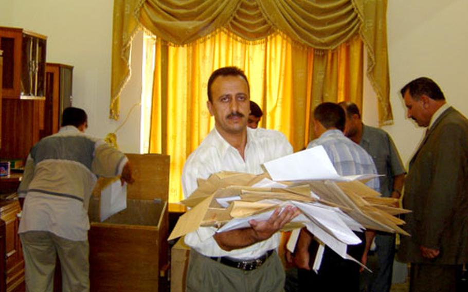 The Provincial Reconstruction Development Committee, or PRDC, overseeing Salah-Ad-Din province opens boxes filled with thousands of bid proposals for public works projects.