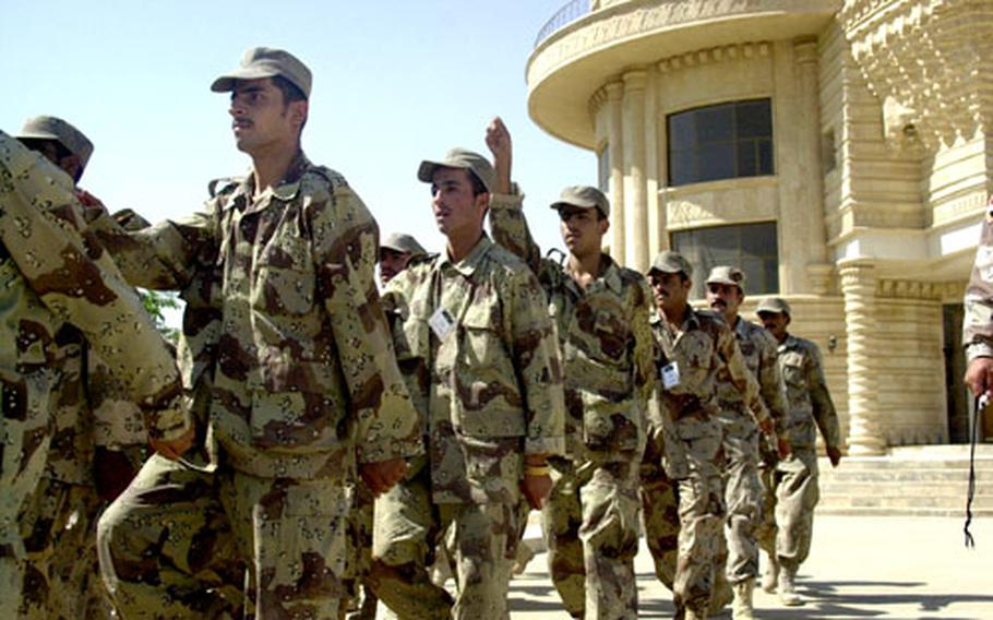"""Iraqi Army trainees march Saturday at """"Iraqi Island"""" on Forward Operating Base Danger in Tikrit, Iraq, as part of their basic training. Trainees spend four weeks learning soldiering skills under Iraqi drill instructors who have been trained by U.S. soldiers."""