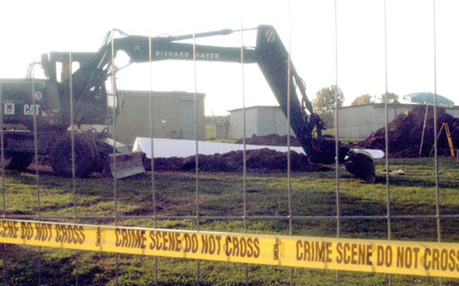 A tent covers a site at the Stuttgart Army Airfield where workers discovered human bones Tuesday while expanding the airfield's main security gate.