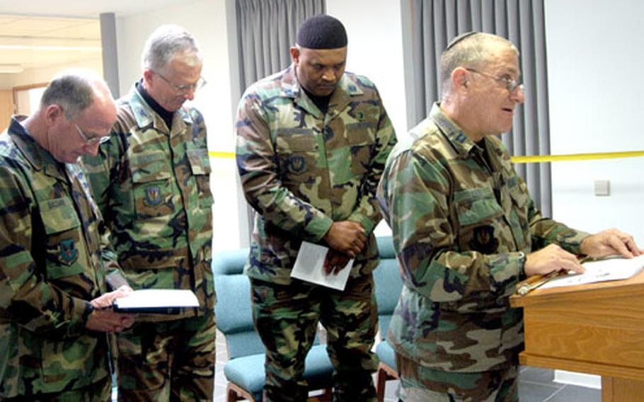 Chaplain (Maj. Gen.) Charles Baldwin, chief of the Air Force chaplain service, Chaplain, (Col.) Richard Elliot, 435th Air Base Wing chaplain and Muslim Chaplain (Capt.) Hamza Al-Mubarak, from left, listen to Jewish Chaplain (Capt.) Donald Levy say a prayer at the dedication ceremony of the interfaith center at Ramstein Air Base, Germany's Southside Chapel.