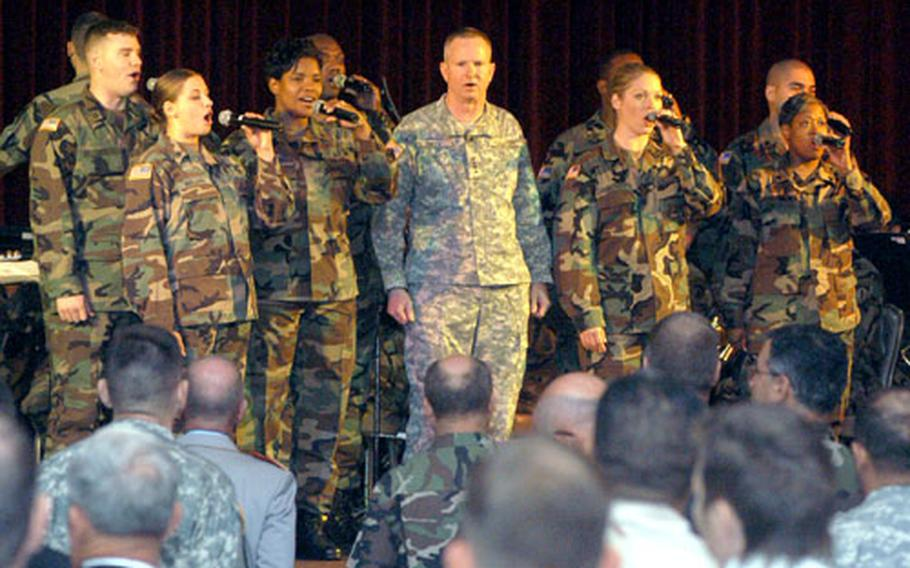 Gen. B.B. Bell, center, United States Army Europe commander, sings with the USAREUR Band and Choir to kick off Land Combat Expo 2005 in Heidelberg on Wednesday.