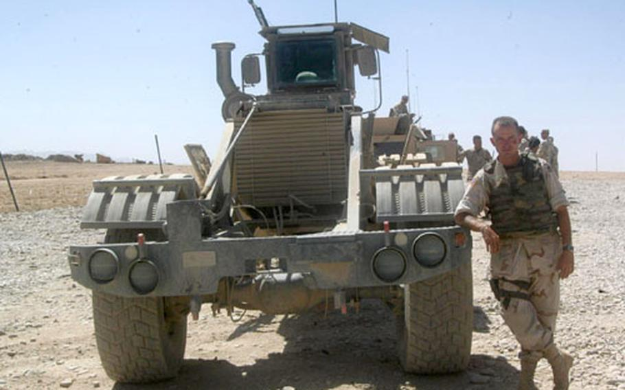Spc. David Rhames has a love-hate relationship with the vehicle he drives in Afghanistan. The South African-made Husky looks like a cross between a tractor and a bulldozer, and isn't fun to drive. But it's proved to be good at detecting improvised explosive devices and land mines.