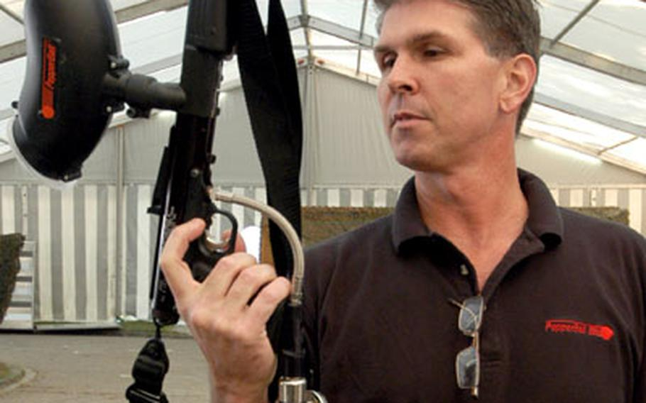 Jon Magin of Non Lethal Solutions International shows a semi-automatic PepperBall SA 200 launcher, that can fire 200 pava pepper powder-filled balls without reloading.