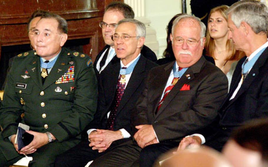 Other Medal of Honor recipients await the start of Friday's White House ceremony honoring Korean War hero Tibor Rubin.