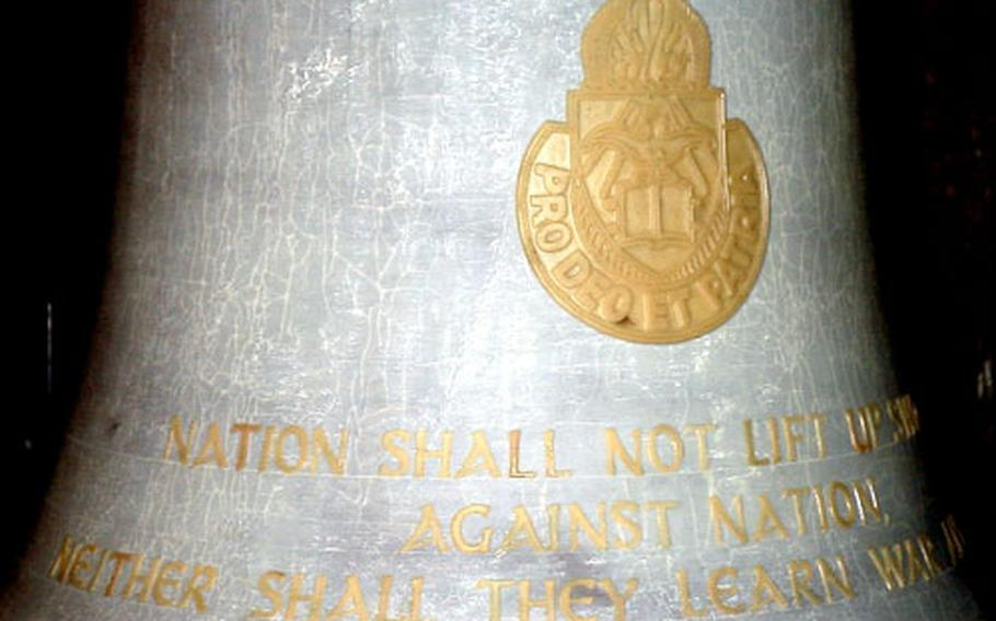 A close-up of the larger bell.