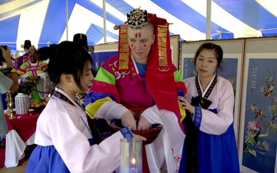 Maj. Stacie Hatten gets ready for the re-creation of a traditional Korean wedding.