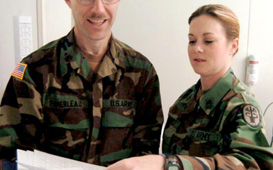 Lt. Col. John Pamerleau, left, and Sgt. 1st Class Jenny Dewhurst are both Army reservists who have chosen to extend their yearlong deployments at Landstuhl Regional Medical Center in Germany.