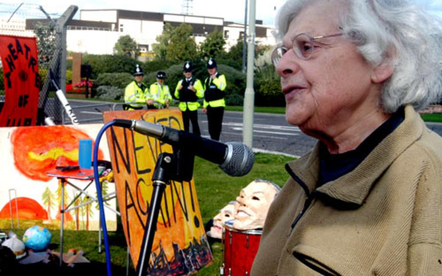 Davida Higgin, 78, the organizer of the anti-nuclear Lakenheath Action Group, reads a letter Sunday to the 48th Fighter Wing commander during a demonstration outside RAF Lakenheath, England.